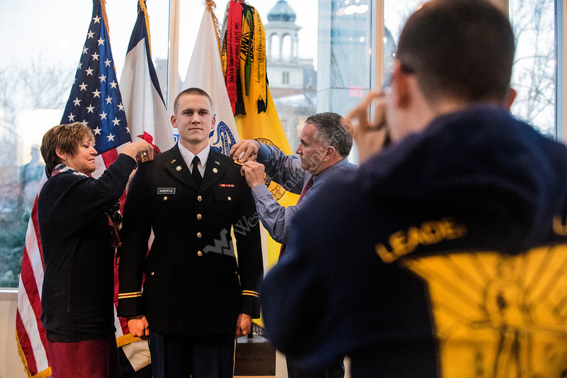 Second Lieutenant Jay Koepfle, graudating with a bachelor of science in business administration is pinned by his parents, Jay and Marsha Keopfle duing theARMY ROTC Commissioning ceremony in the Mountaineer Room of the Mountainlair December 14th, 2017.  Photo Brian Persinger