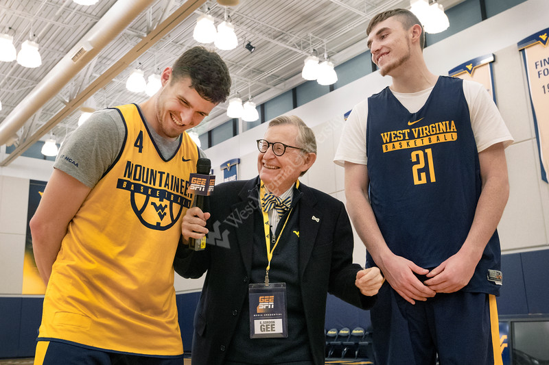 """WVU President E Gordon Gee interviews and plays basketball with the WVU men's basketball team and coaches as part of his ongoing """"Gee Mail"""" series December 13, 2017. Photo Greg Ellis"""