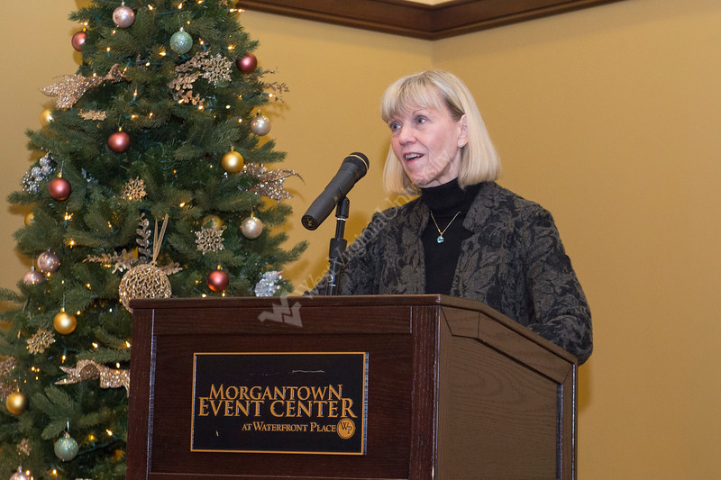 Faculty of WVU and friends of Joan Gorham attend a reception in honor of her retirement at the Waterfront Hotel on December 13, 2017.