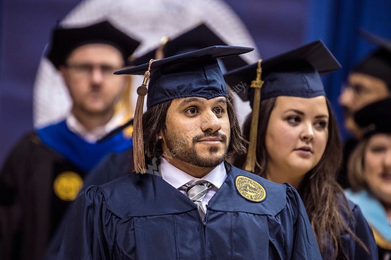 Students from the College of Business and Economics process in during the Eberly College of Arts and Sciences and the College of Business and Economics  December Commencement in the Coliseum December 15th, 2017.  Photo Brian Persinger