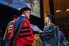 Makenzie Defranceo receives her degree in Animal and Nutrition Sciences from Davis College Dean Ken Blemings at December Commencement in the Coliseum December 21st, 2019.  (WVU Photo/Brian Persinger)