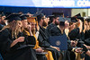 Makenzie Defranco, an Animal and Nutrition Sciences major, Micah Cuningham an Environment, Water and Soil Sciences major and Megan Crumligh a Biochemistry major move their tassles at the conclusion of December 2019 Commencement in the Coliseum December 21st, 2019.  (WVU Photo/Brian Persinger)