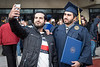 WVU graduate Ahmed Alisaii poses for a selfie with a friend at the WVU December Commencement December 21, 2019. (WVU Photo/Greg Ellis)