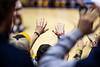 Fans hold their hands high for a free throw. The WVU Men's Basketball team took on Rhode Island at the Coliseum December 1, 2019. (WVU Photo/Parker Sheppard)