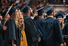 """Makenzie Defranco, an Animal and Nutrition Sciences major, Micah Cuningham an Environment, Water and Soil Sciences major and Megan Crumligh a Biochemistry major sing, """"Country Roads"""" at the conclusion of December 2019 Commencement in the Coliseum December 21st, 2019.  (WVU Photo/Brian Persinger)"""