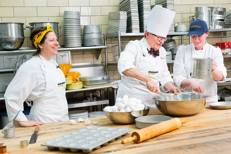 l to r Barbara Yanera, E Gordon Gee, Cassie Cassandra Heaster, baking WVU Birthday cake Towers kitchen 1/29/2015 .