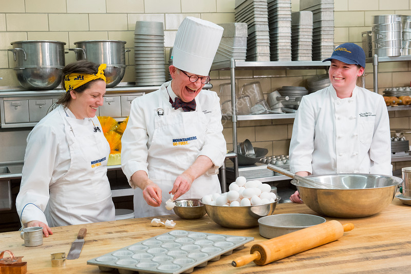 l to r Barbara Yanera, E Gordon Gee, Cassie Cassandra Heaster, baking WVU Birthday cake Towers kitchen 1/29/2015 .