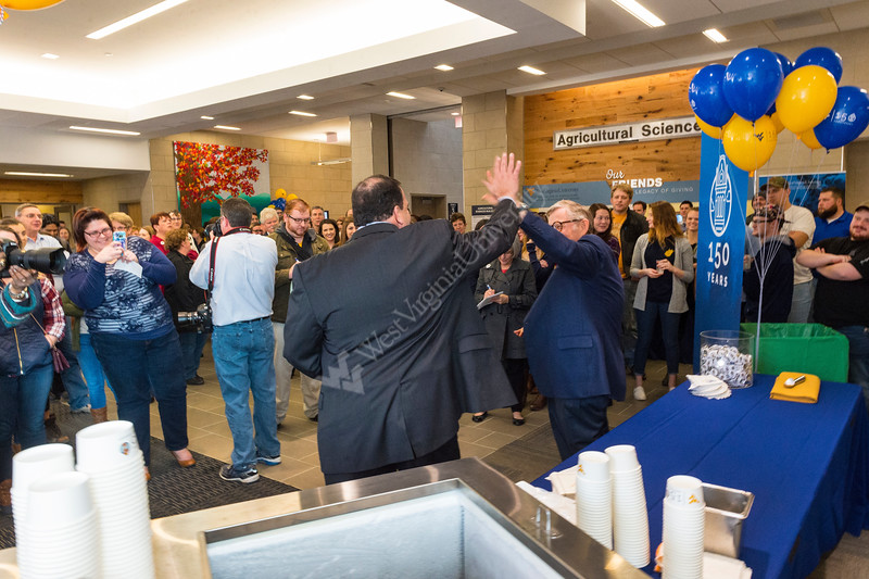33105, WVU Davis College Dean, Daniel J. Robison and WVU President E. Gordon Gee, high-five in celebration