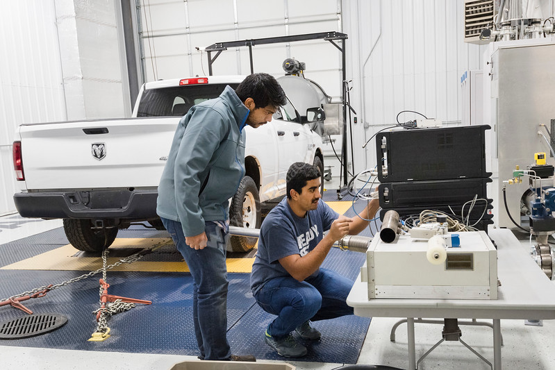 33087, WVU student researchers prepare a Dodge Ram in the WVU CAFE Vehicle Engine Testing Lab (VETL)