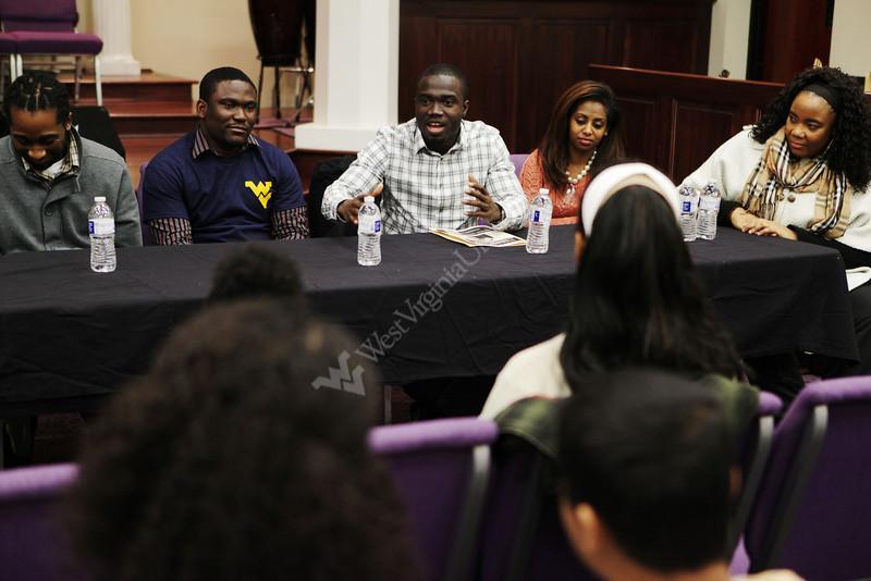 Chancellor Scholar Kofi Nkansah speaks with minority youth from the Charleston community.