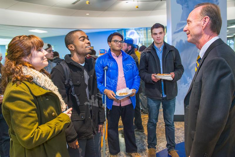 William D Schaffer, president of student life talks with wvu students at pizza reception mnt lair 01/16/2015. L to R Carelee Lammers, Fredrick Md , Stephen Scott, Shepherdstown WV, Ankur Kumar, Charleston WV, Roger McIntyre, Bridgport WV,