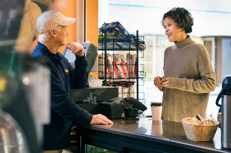 Lauri Andress, MPH, JD, PhD, Assistant Dean for Public Health Practice and Workforce Development at the WVU School of Public Health interacts with staff at Cavanaugh's coffee place located on  HSC campus January 4, 2018. Photo Greg Ellis
