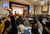 Students and those in attendance raise their hands during Eugene Napoleon's keynote address during the 25th Anniversary MLK Breakfast at the Mountainlair January 20th, 2020.  (WVU Photo/Brian Persinger)