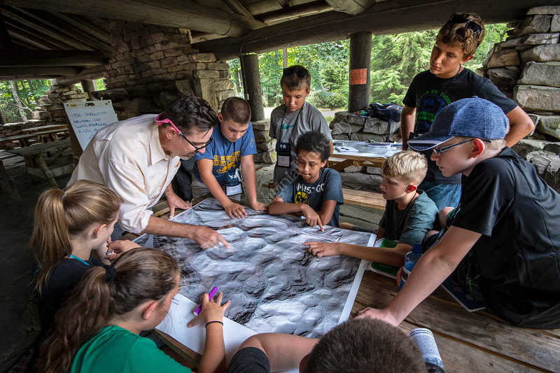 WV 4H Middle school students taking part in the WVU ArgiSTEM Camp held at Coopers Rock State Forest review LiDAR maps with Peter Butler, a landscape architecture professor at the Davis College, as part of a  Industrial Landscape Archaeology Session. July 24, 2018. Photo Greg Ellis