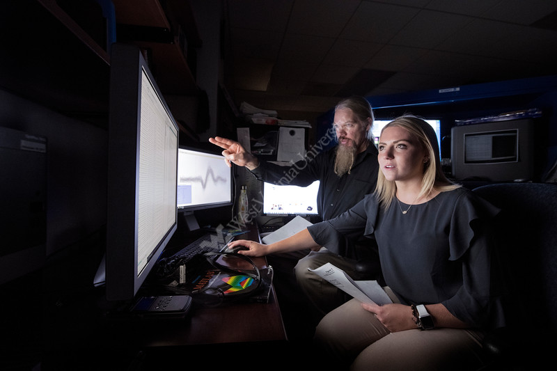Professor James Lewis and Molly Layne conduct research on vocal sounds and the brain in the Rockefeller Neurosciences Institute at the Health Sciences Center July 24th, 2018.  Photo Brian Persinger