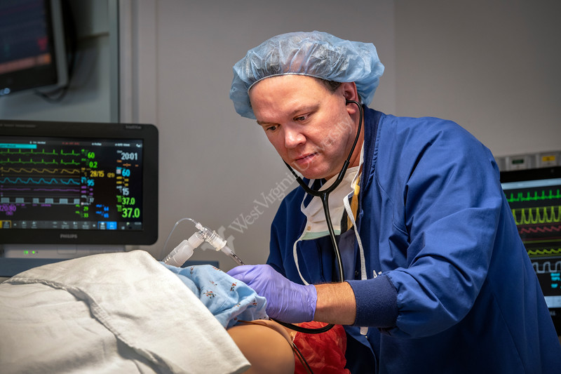 Aaron M. Ostrowski Clinical Assistant Professor, Nurse Director Anesthesia Program poses for photos with the METI simulator in the STEPS lab  WVU HSC campus. July 25, 2018. Photo Greg Ellis