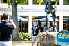 Patrick Hoban has his picture taken with the mountaineer statue at NSO on June 28, 2019. Photo Parker Sheppard