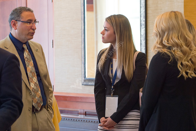 Attendees of the WVU Employer Networking Reception mingle in the conference center of the  Waterfront Place Hotel June 27, 2017. The summit included WVU students, faculty and representatives of several different companies, such as PepsiCo.