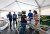 WVU School of Public Health students interring with the WV Mon County Health Department  provide information to Fort Martin power plant employees at the Fort Martin Power Station Health Fair, June 21, 2018. Photo Greg Ellis