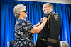 WVU Police Chief of 28 years Bob Roberts  selected 2018 Chief of the Year by the National Association of Campus Safety Administrators, Has his WVU Police retirement badge pinned by his wife at his retirement ceremony Erickson Alumni Center June 27, 2018. Photo Greg Ellis