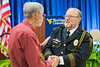 WVU Police Chief of 28 years Bob Roberts  selected 2018 Chief of the Year by the National Association of Campus Safety Administrators, greets Retired WVU professor Mike Klishis Statler College department of Safety Management at his retirement ceremony Erickson Alumni Center June 27, 2018. Photo Greg Ellis