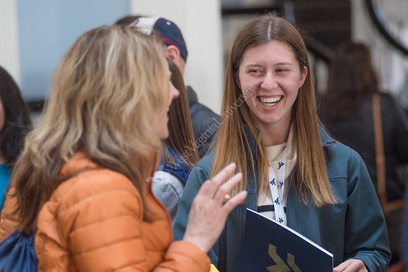 Potential future students of WVU visit the University on Decide Day, on March 23, 2019, to learn more and explore campus. In E. Moore Hall, Legacy Students received their pins and others learned about the benefits of WVU's Honors College.