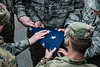 "ROTC Cadets lower the U.S. flag and ""retire the colors"" for the final time in front of Stansbury Hall during a brief and reserved ceremony in front of the historic brick building along Beechurst Avenue March 8th, 2019.  Photo Brian Persinger"