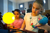 Natalie Esposito (right) and her sister, Elizabeth tinker with a solar model that shows how the moon crosses between the Earth and Sun to cause eclipses at the Physics booth in the When I Grow Up... event Wednesday, March 29, 2017 in the Museum Education Center. When I Grow Up... is an event to show young girls some of the different paths available for them to pursue as they grow older.