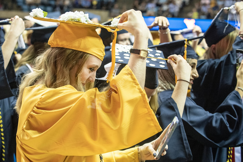 Samantha Aretz, a graduate in the department of Psychology moves her tassle during the conclusion of the Eberly College of Arts and Sciences Undergraduate Commencement at the Coliseum May 12th, 2019.  Photo Brian Persinger