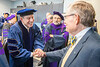 Honorary Doctoral Degree recipient Robert Fitzsimmons shakes hands with WVU President Gordon Gee prior to the College of Law Commencement at the Creative Arts Center May 10th, 2019.  Photo Brian Persinger
