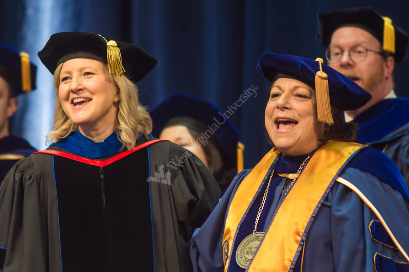 Dean of the College of Education and Human Services, Tracy Morris, and Provosts and Vice President for Academic Affairs, Joyce McConnell, joyfully chant Country Roads after the commencement of the Graduation Ceremony. Eligible students of CEHS attended their commencement ceremony at the Coliseum on May 11, 2019.