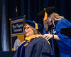 Elizabeth Cohen Associate Professor Comm Studies hoods graduate student Cathelin Clark Gordon at the Eblery May Graduate Commencement, WVU Coliseum May 12, 2019. Photo Greg Ellis