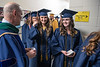 VP of Health Sciences Center Clay Marsh congratulates graduates in line to enter the stage at the School of Public Health May Commencement at the Creative Arts Center May 10th, 2019.  Photo Brian Persinger