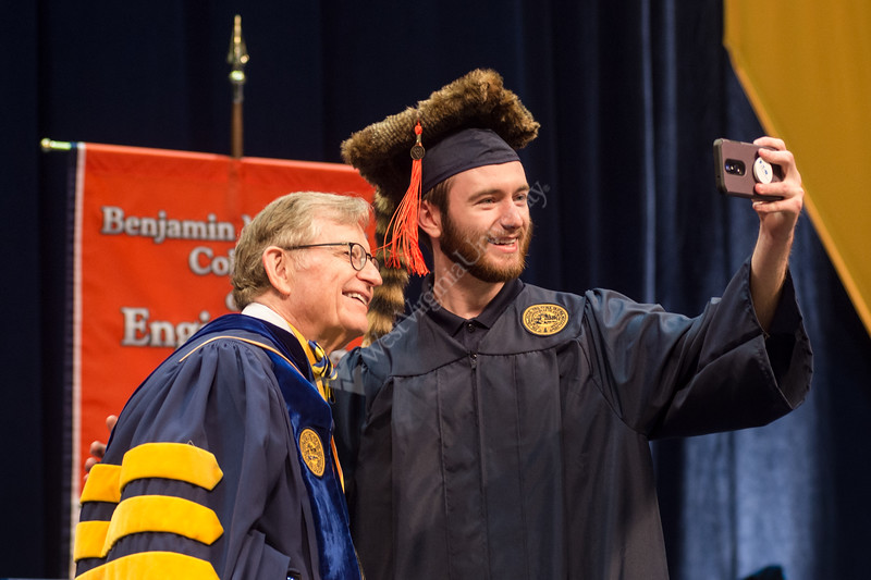 Caleb Houdyschell, now a graduate of the Statler College of Engineering, catches his last selfie with University President Gordon Gee.  The Statler College of Engineering commencement ceremony was held at the Coliseum on May 5, 2019. The students received their diplomas and greeted their families outside afterward.