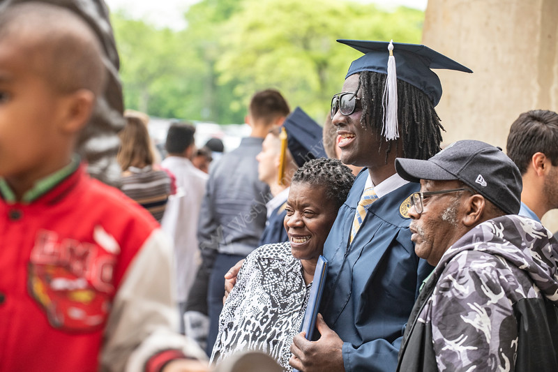 Eric Butler poses with his mother Ann and father Julian Butler near the Jerry West Statue after the conclusion of the Eberly College of Arts and Sciences Undergraduate Commencement at the Coliseum, May 12th, 2019.  Photo Brian Persinger