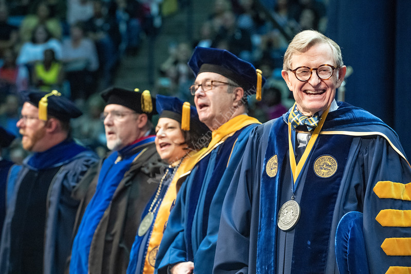 WVU President Gordon Gee pauses during the singing of Country Roads to smile during the conclusion of the Eberly College of Arts and Sciences Undergraduate Commencement at the Coliseum May 12th, 2019.  Photo Brian Persinger