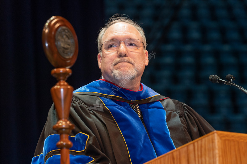 Eberly College Dean Gregory Dunaway addresses Eberly May Graduate Students, families and friends attending the Commencement at the WVU Coliseum May 12, 2019. Photo Greg Ellis
