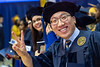 WVU Statler College Graduate Lei Bai smiles and flashes the victory sign at the Statler May Commencement bringing graduates, family and friends together at the WVU Coliseum to celebrate graduates achievements, May 11, 2019. Photo Greg Ellis