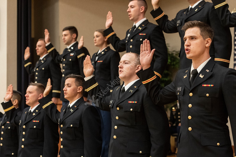 WVU May ROTC Graduates take the Oath of Office as their families and friends look on during the Army ROTC commissioning ceremony at the Mountain Lair Blue and Gold ball rooms, May 9, 2019. Photo Greg Ellis