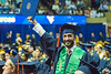 Hadi Alameer, now among WVU alumni, proudly displays his diploma to his parents in the crowd. The Statler College of Engineering commencement ceremony was held at the Coliseum on May 5, 2019. The students received their diplomas and greeted their families outside afterward.