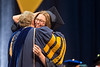 University President, Gordon Gee, and Sarah Shadle, a now graduated student of the Statler College of Engineering embrace each other cheerfully on stage. The Statler College of Engineering commencement ceremony was held at the Coliseum on May 5, 2019. The students received their diplomas and greeted their families outside afterward.