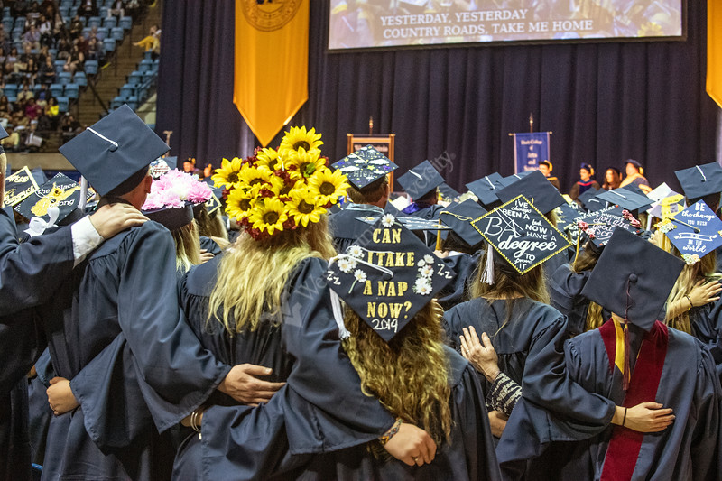 Graduates sing Country Roads during the conclusion of the Eberly College of Arts and Sciences Undergraduate Commencement at the Colseum May 12th, 2019.  Photo Brian Persinger