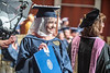 Rana Radwan looks back towards family in the crowd after receiving her diploma at the School of Public Health Commencement at the CAC May 10th, 2019.  Photo Brian Persinger