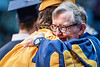 WVU President Gordon Gee hugs graduates during the Eberly College of Arts and Sciences Undergraduate Commencement at the Coliseum May 12th, 2019.  Photo Brian Persinger