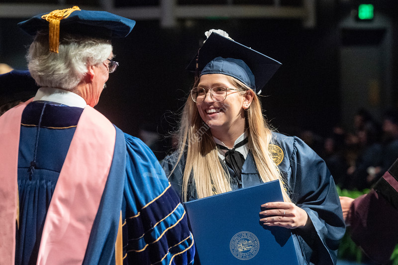 CAC graduate Leigha Takacs BFA Sculpture is greeted on stage by HDOC Jay Chattaway at the CAC graduation May 10, 2019. Photo Greg Ellis