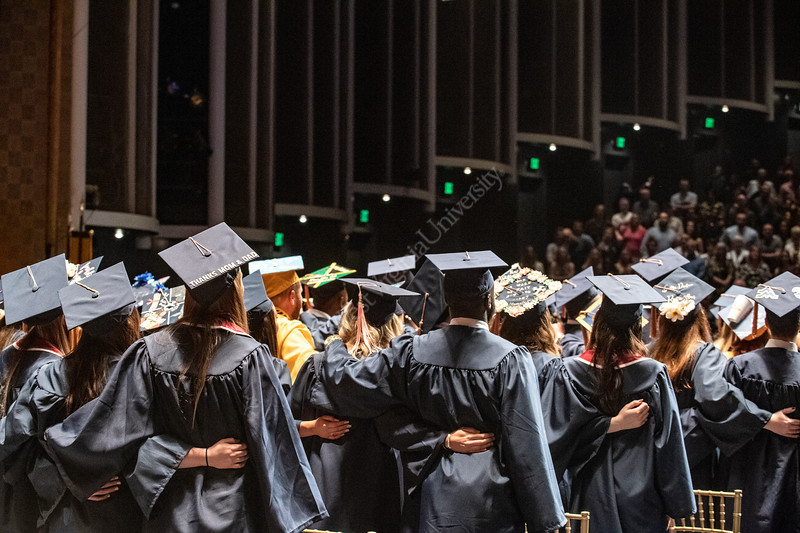 """Graduates embrace and sing, """"Country Roads"""" at the conclusion of the School of Public Health Commencement at the CAC May 10th, 2019.  Photo Brian Persinger"""