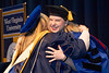 Elizabeth Cohen Associate Professor Comm Studies hugs graduate student Cathelin Clark Gordon after hooding at the Eblery May Graduate Commencement, WVU Coliseum May 12, 2019. Photo Greg Ellis