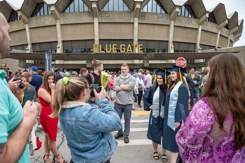 Hannah Dawson, a department of Nutritional Sciences at the Davis College poses with her cousin Jaden Dawson a department of Biology graduate at the Eberly College of Arts and Sciences Undergraduate Commencement at the Coliseum May 12th, 2019.  Photo Brian Persinger