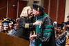 School of Public Health Dean Jeffrey Coben hugs Huntington, W.V. Fire Chief Jan Rader after addressing the crowd at the School of Public Health Commencement at the CAC May 10th, 2019.  Photo Brian Persinger