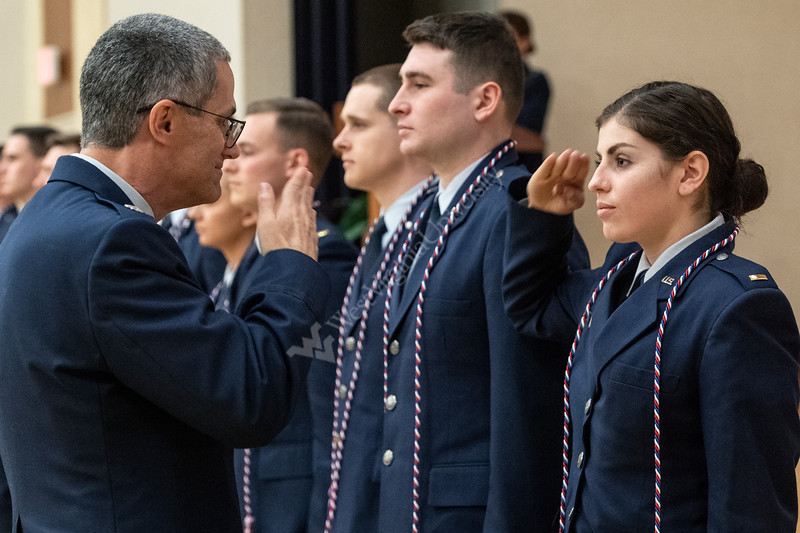 Newly commissioned second lieutenant Alexandra Barnes receives a salute and a service cord from her commander LT. Colonel Greg Tobin at the WVU Air ROTC Commissioning Ceremony May 10, 2019. Photo Greg Ellis